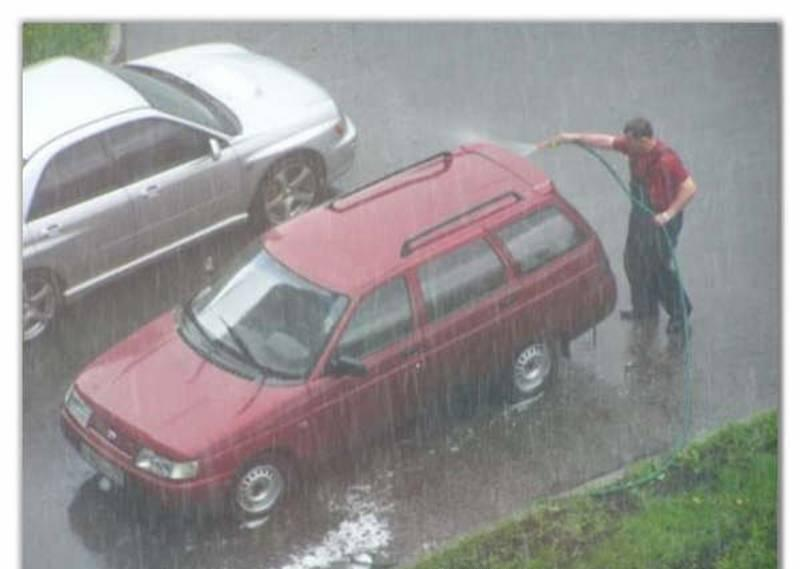 Washing car in rain.JPG